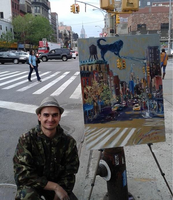 Художник Роман Ромулен (Рахматулин)  со своей картиной, на которой изображен любимый персонаж Синий Пес
